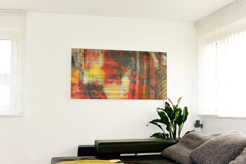 Die Infra Evolution Infrarot Wandheizung mit Bild, im Wohnzimmer eines Kunden.